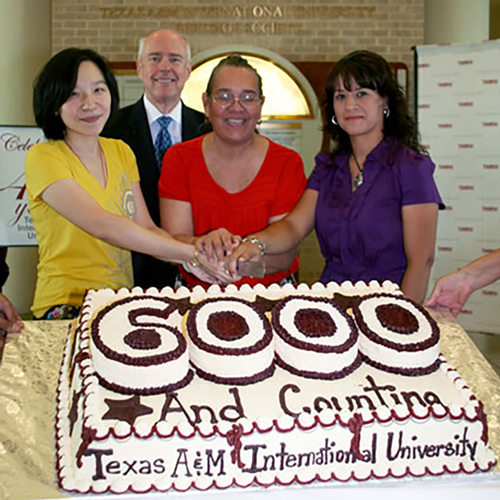 Left to right: TAMIU's 6000th student, Mengxuan (Michelle) Ding; Dr. Keck; 3000th student Esther Buckley and 5000th student Selma Lopez. Not pictured is the 4000th student, Griselda Canales.