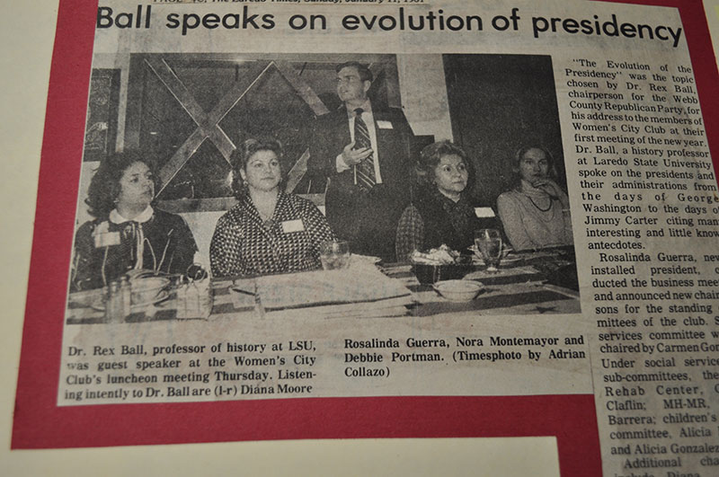 Dr. Rex Ball (standing) is lecturing while four women are pictured listening intently.