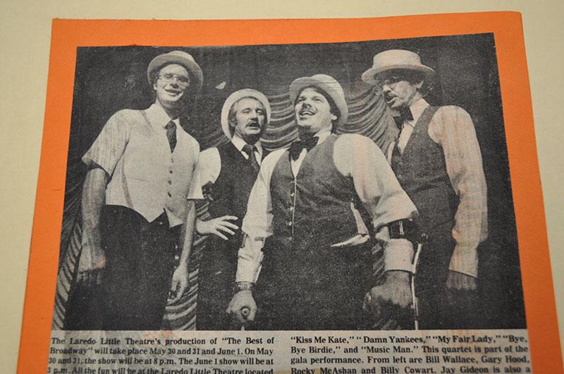 A quartet, in typical barber shop quartet fashion, is photographed singing.