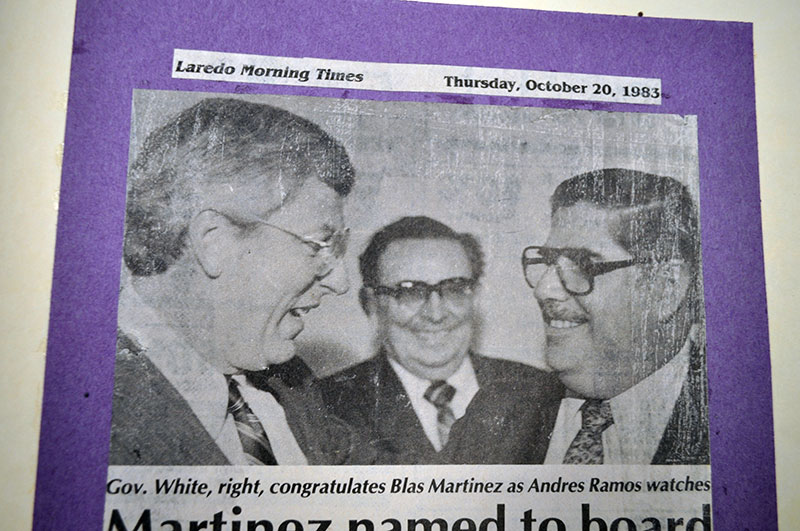 Gov. White, right, congratulates Blas Martinez as Andres Ramos watches with a smile.