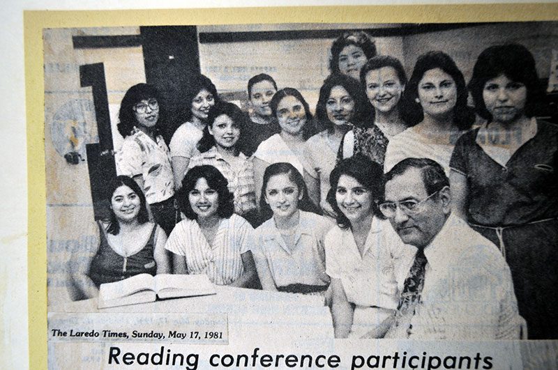 Dr. Hinojosa is photographed with fourteen individuals.