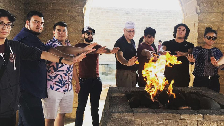 TAMIU students enjoy a nice fire during the Baku trip.