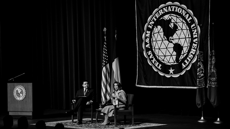 The Honorable Speaker of the U.S. House of Representatives, Nancy Pelosi, speaks on stage with U.S. Congressman Henry Cuellar.