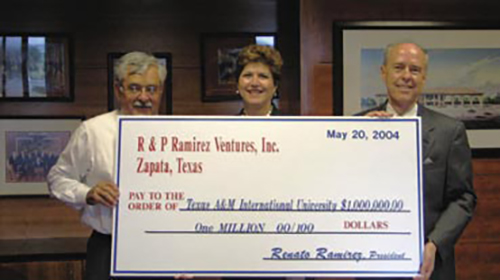 Renato and Patricia Ramirez with Dr. Keck holding the donation check.