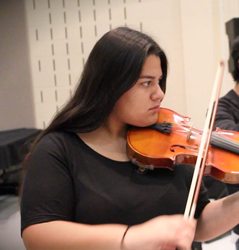Photo of female student playing a violin