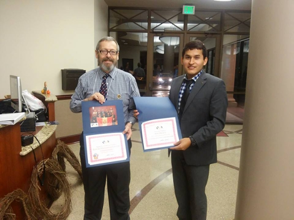 Dr. Norris congratulates Carlos Alvarez on his performance at the ESMOAS Summit.