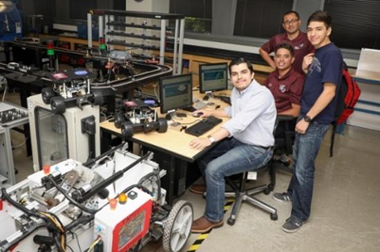 Students Roberto Ponce, Jose I. Segura and Anthony Martinez join Dr. Tashtoush in using the ARM gift.
