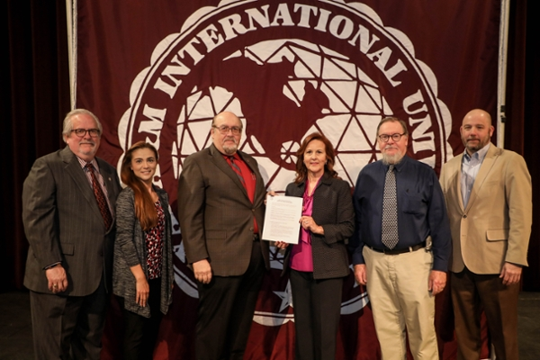 Celebrating the signing of the MOU between TAMIU and the Laredo Theater Guild International are, left to right: Dr. Tom Mitchell, TAMIU Provost; Dr. Claudia San Miguel, Dean, College of Arts & Sciences; Dr. Pablo Arenaz, TAMIU President; Linda Lopez Howland, President, LTGI; Vernon Carroll, LTGI, and Chris Morgan, LTGI.
