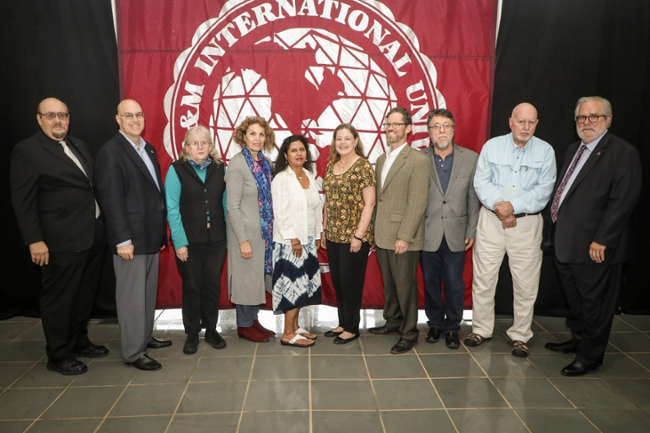 TAMIU faculty authors were celebrated with a special reception in the Sue and Radcliffe Killam Library. Left to right, Dr. Pablo Arenaz, president; Dr. John Kilburn, Dr. Judith A. Warner, Dr. Lola O. Norris, Dr. Mehnaaz Momen, Dr. Diana Linn, Dr. John E. Dean, Dr. Robert W. Haynes, Dr. Jerry D. Thompson and Provost Dr. Tom Mitchell.
