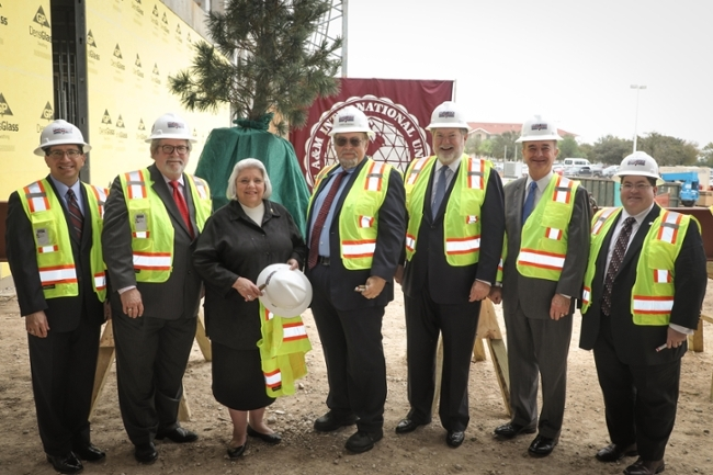 TAMIU's Topping-Off Ceremony celebrated a milestone with those who have helped to make the new Academic Hall and Laboratory a reality. Left to right, Juan Castillo, TAMIU vice president for Finance and Administration; Dr. Tom Mitchell, provost and vice president for Academic Affairs; State Senator Judith Zaffirini; TAMIU president Dr. Pablo Arenaz; chairman of The Texas A&M University System Board of Regents, Charles W. Schwartz; A&M System Chancellor, John Sharp, and Trevor Liddle, TAMIU associate vice president for Administration.