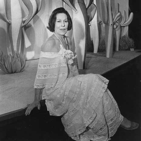Helen Watson in an elegant dress.