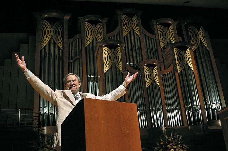 Mr. Corrigan in front of the organ