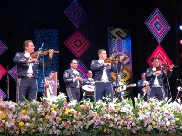 Mariachi players on stage performing.